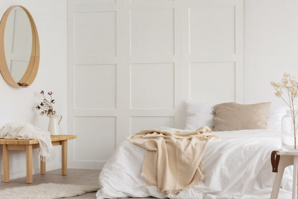 White simple bedroom design with mirror, dresser and comfortable